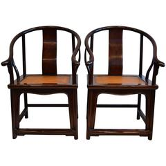 Pair of Early Chinese Horseshoe Back Arm Chairs
