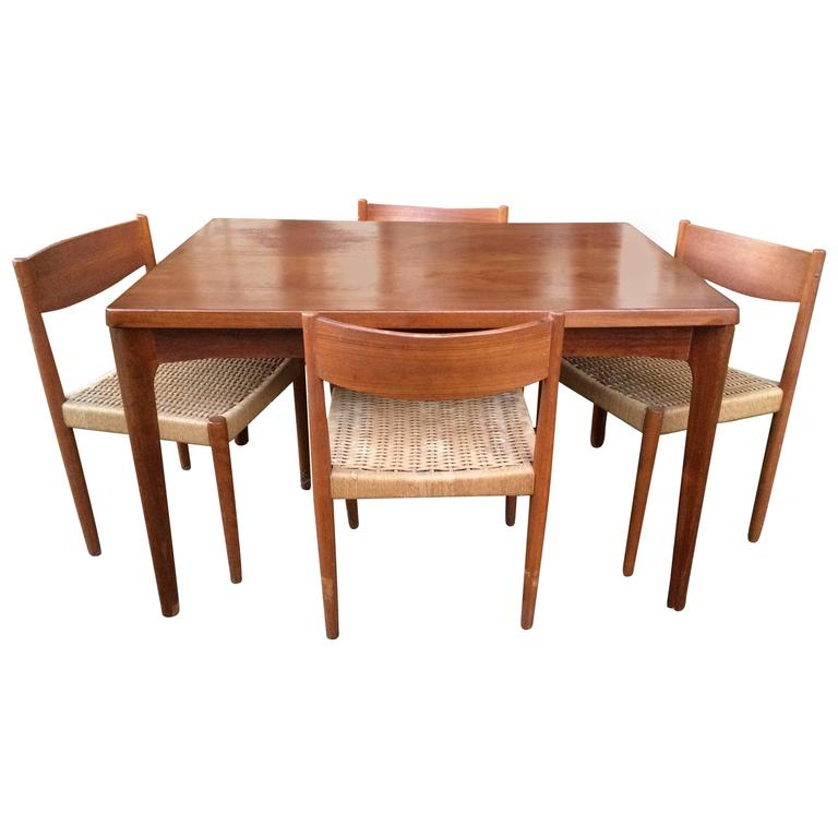Danish Modern Extendable Teak Dining Table With Woven Chairs For
