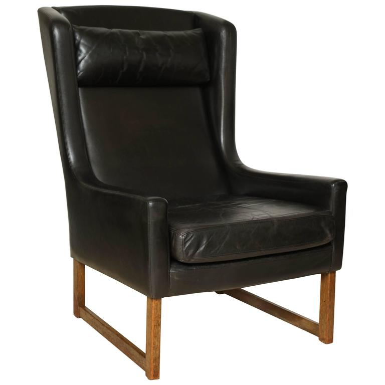 mid 20th century black leather wing chair cross stretcher square legs at 1stdibs. Black Bedroom Furniture Sets. Home Design Ideas