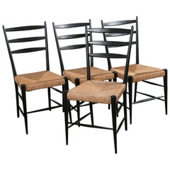 Set of Four Black Lacquer & Rattan Chairs