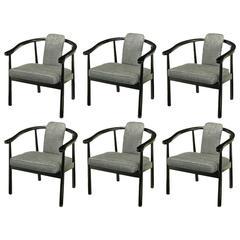 Six Slate Grey Linen Upholstered and Ebonized Yoke Arm Dining Chairs