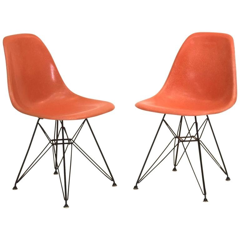 orange eames shell chairs on original eiffel bases for
