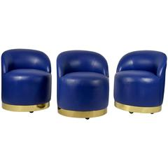 Karl Springer Style Chairs in Blue Leather with Brass Finish Base on Casters