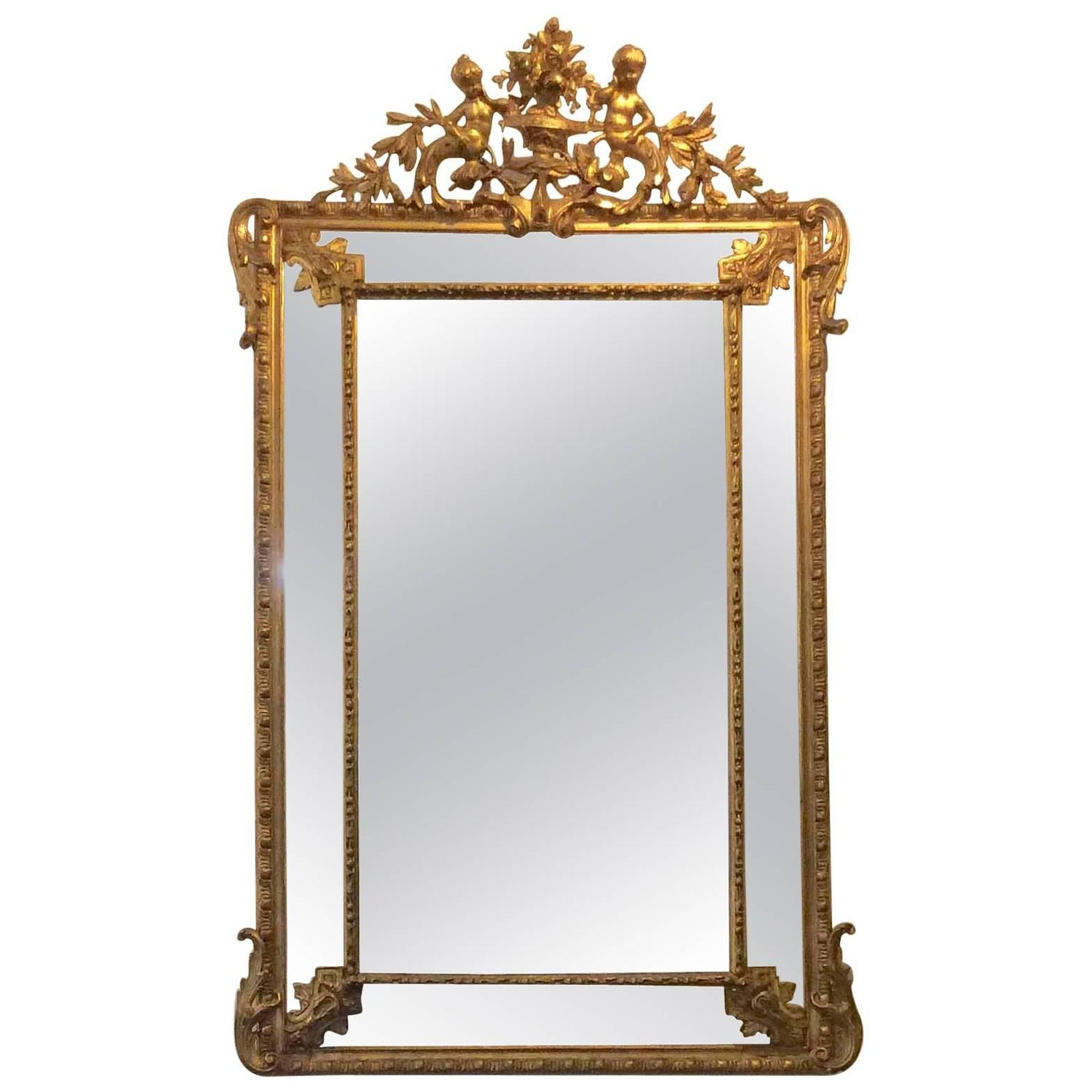 French Gold Gilt Mirror With Cherubs And Beveled Glass For
