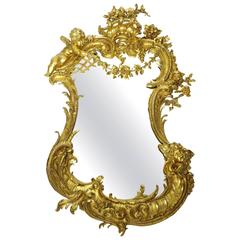 Belle Epoque 19th-20th Century Louis XV Style Giltwood Carved Cherub Mirror