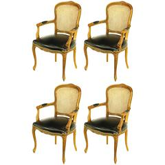 Four Italian Carved Wood and Black Leather Armchairs