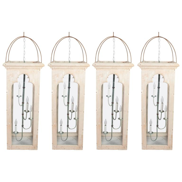 Two Pairs of Lime Painted Gothic Lanterns