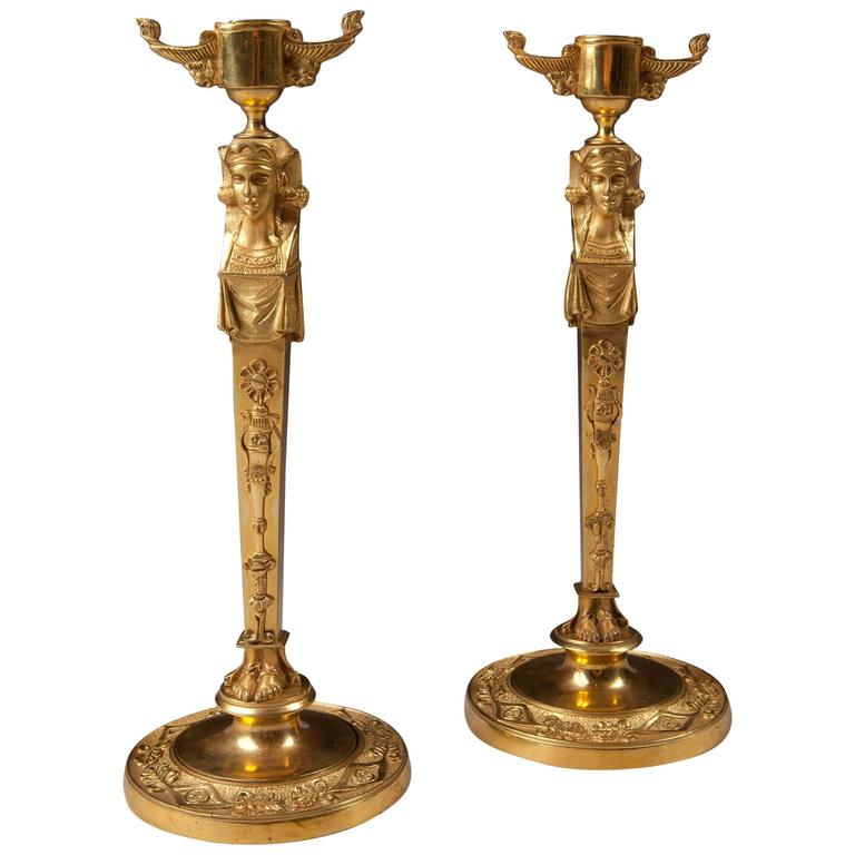 Pair of Neo Egyptian Candlesticks in Gilt Ormolu For Sale