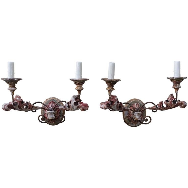 Pair of Italian Two-Light Carved Wood and Painted Sconces