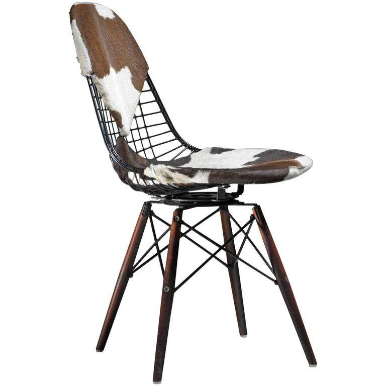 eames dkw wire chair with unique cowskin bikini seat on dowel feet