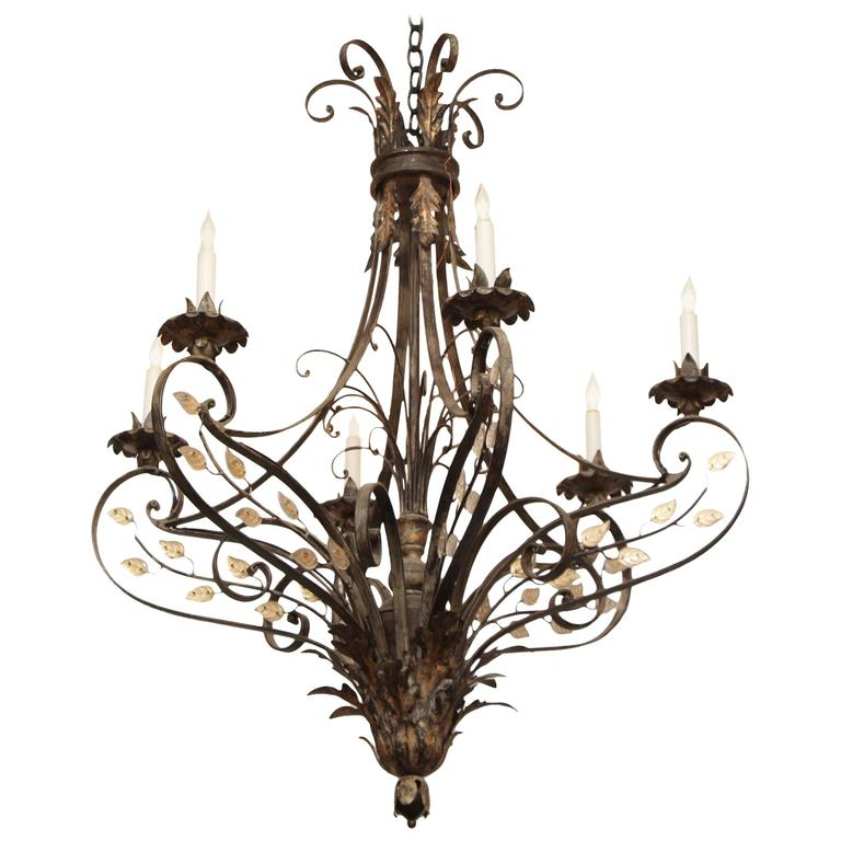 Geyser Wrought Iron Six-Arm Chandelier in a Gold Leaf Finish with Crystal Detail
