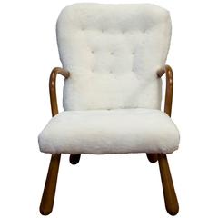Armchair inspired by Philip Arctander's Clam Chair, in sheepskin and beech