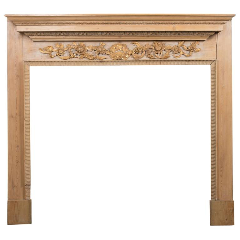 Georgian Style Carved Pined Parcel Gilt Fire Surround For Sale