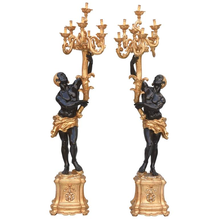 Pair Of Carved Ebonized And Giltwood Blackamoor Torchieres