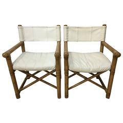 Pair of Leather and Wood Campaign Chairs