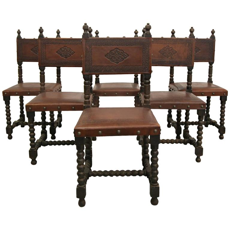Set of six antique spanish colonial stamped leather dining for Antique dining room furniture