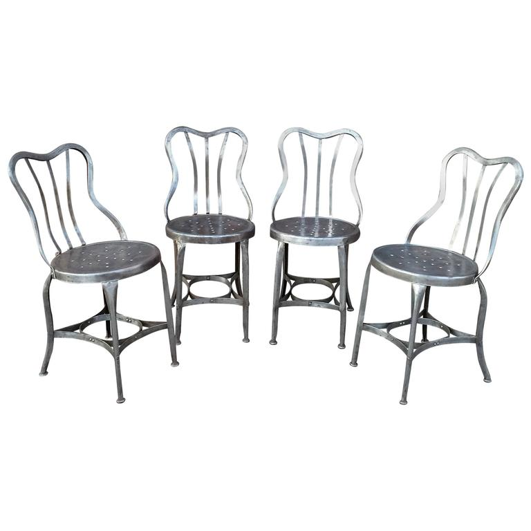 Pair of industrial brushed steel toledo café chairs at stdibs