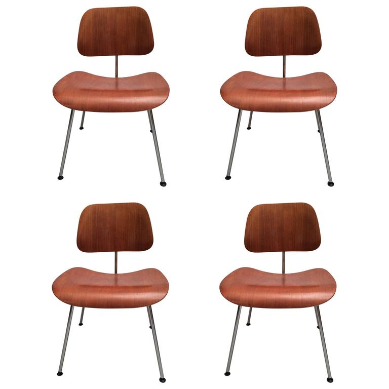 this eames set of four american walnut dcm chairs is no longer