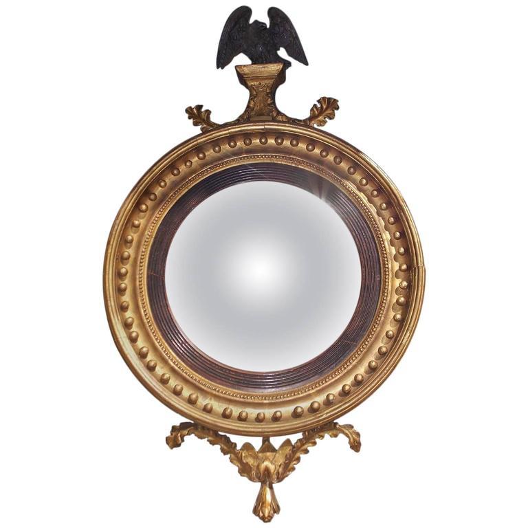 English Gilt Convex Mirror with Ebonized Perched Eagle, Circa 1810