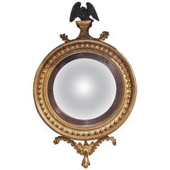 English Gilt Convex Mirror with Ebonized Perched Eagle, Circa 1810