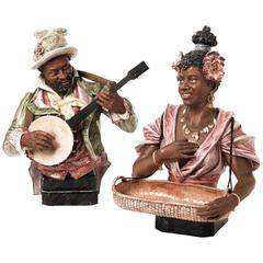 "Pair 19th-20th Century Majolica Busts of ""the Banjo Player and the Flower Lady"""