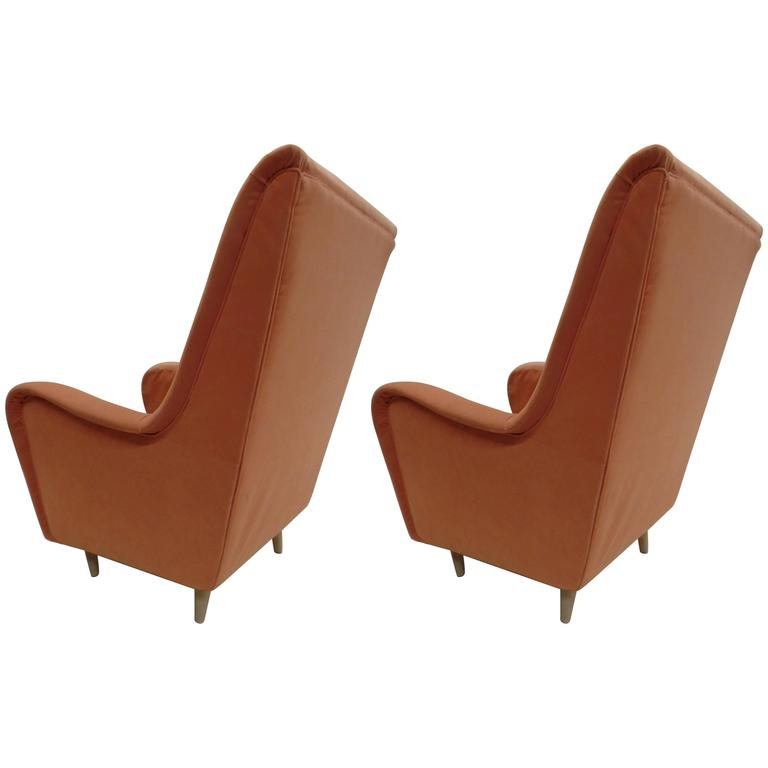 Elegant pair of Italian Mid-Century Modern wingback / armchairs by Paolo Buffa.   These chairs are large, deep and comfortable; they have a similar line as highback armchairs designed by Gio Ponti and the organic feel to the Senior Chairs by Marco
