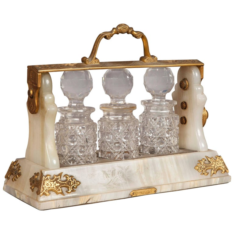 Decorative English Glass Bottle and White Stone Tantalus for Liquor  For Sale