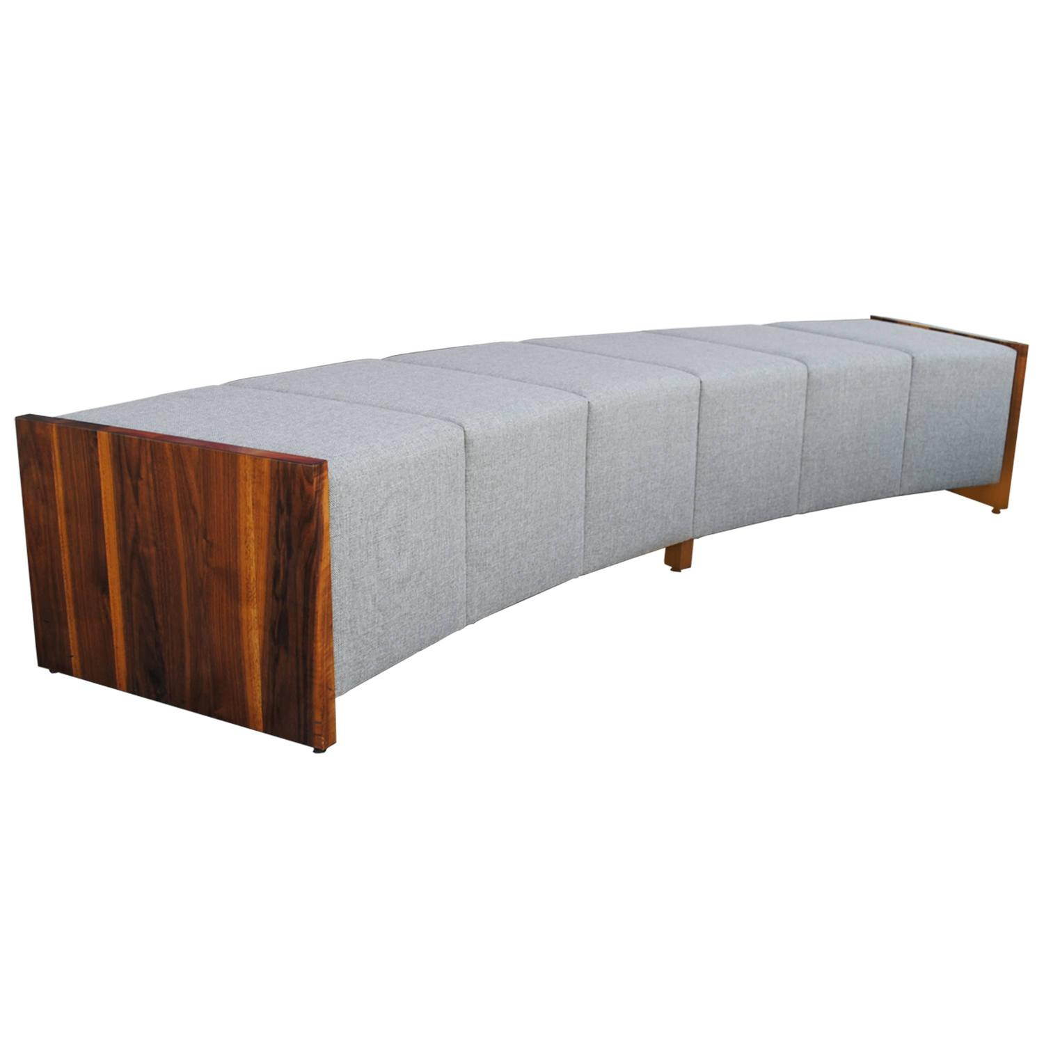 Large modern curved upholstered and walnut bench for sale