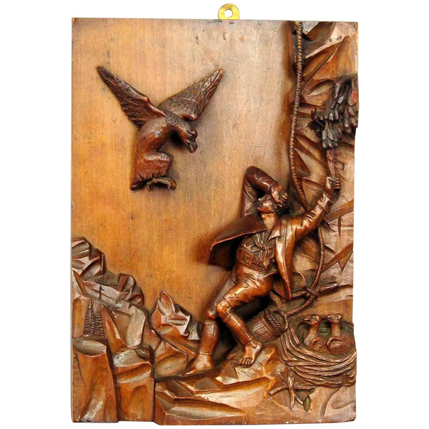 Relief wood carving nest robber black forest circa