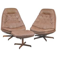 Pair Of 1960s Danish Leather Swivel Chairs With Matching Ottoman