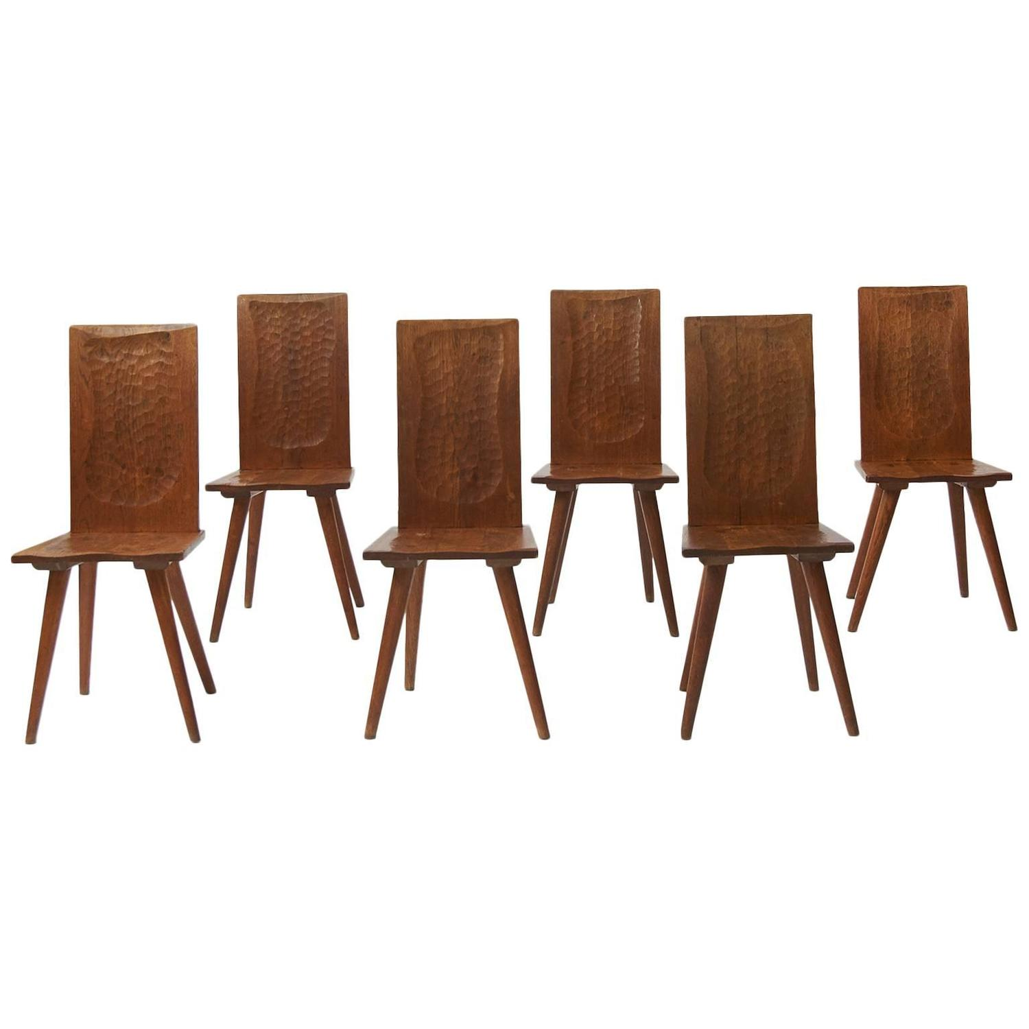 Of four chairs in oak and patinated cognac leather for sale at 1stdibs - Jean Touret Dining Chairs For Atelier Marolles