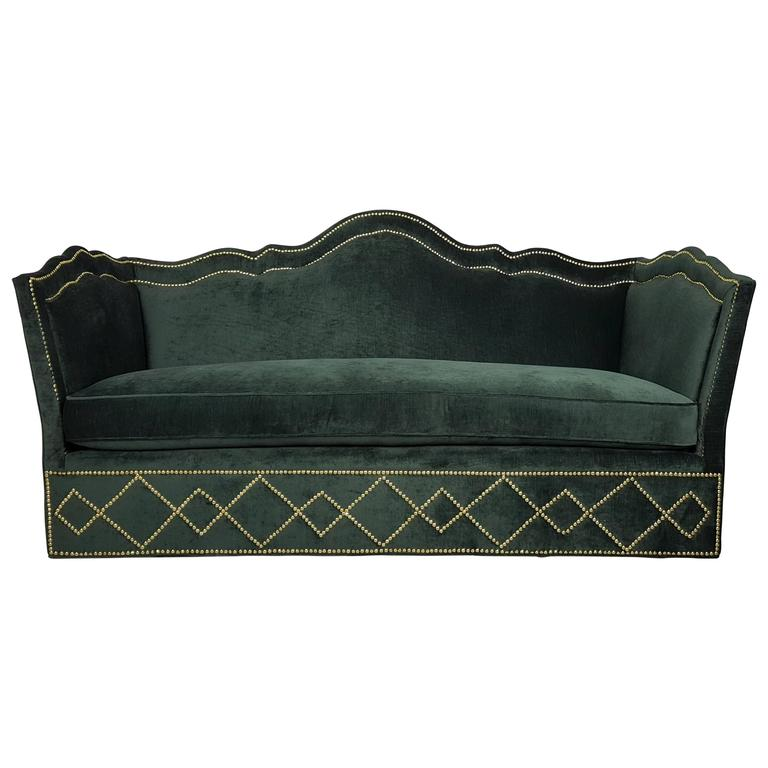 incredibly luxurious sofa with nailhead detail by baker