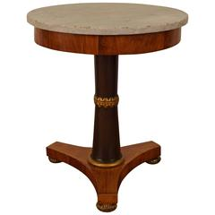 Italian Neoclassic Walnut, Ebonized, Giltwood Marble-Top Center Table