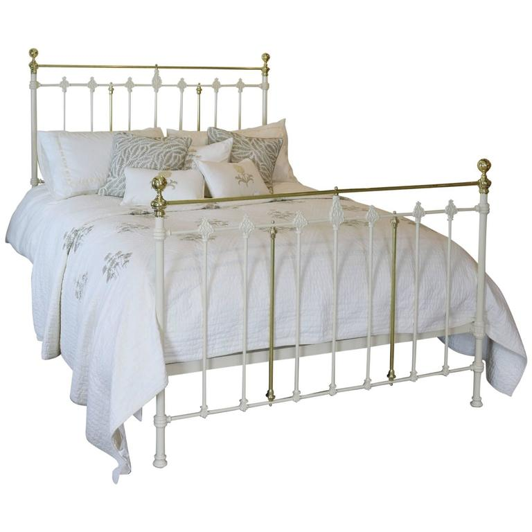 wide brass and iron bedstead in cream at 1stdibs