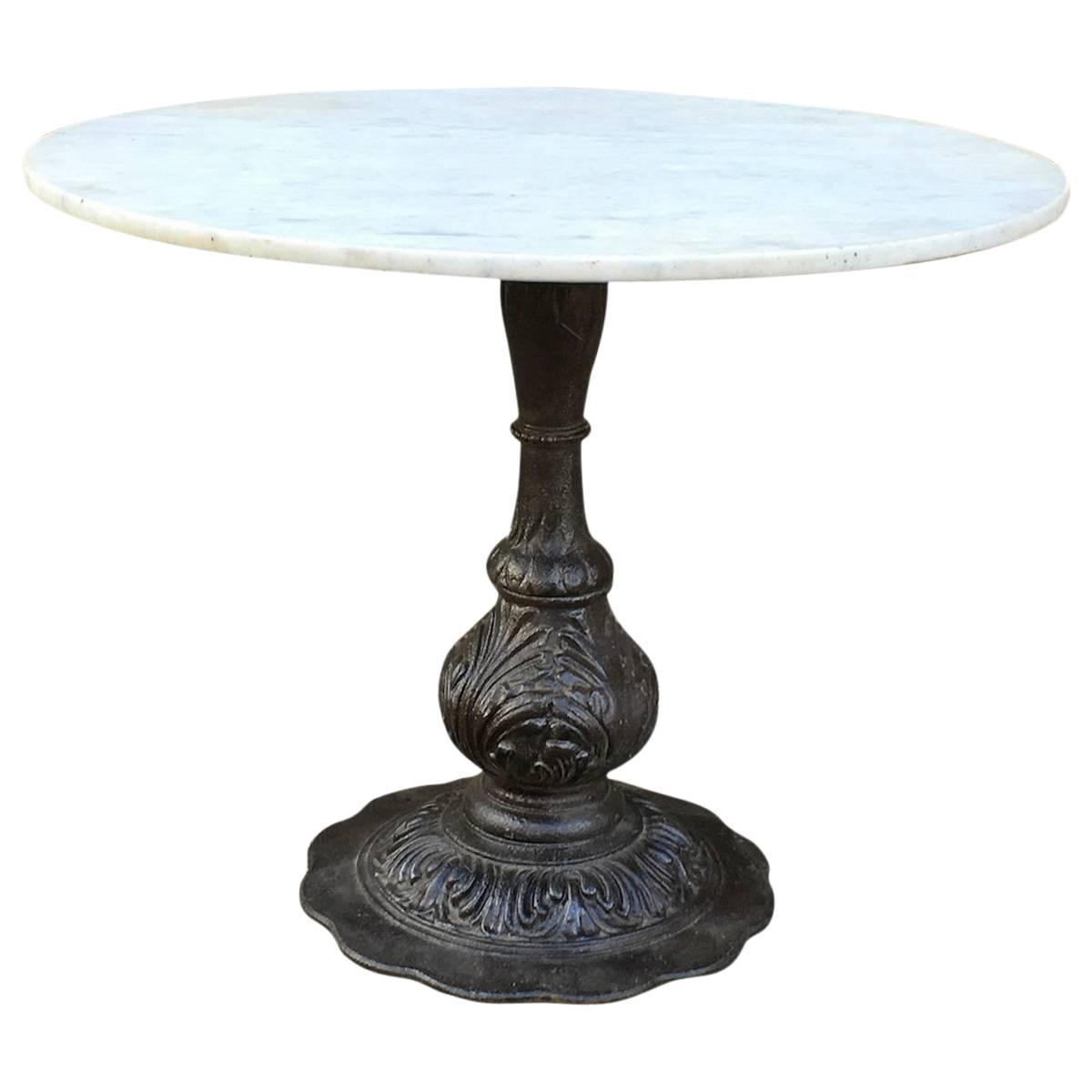 Marble dining table with ornate cast iron base at 1stdibs for Cast iron dining table