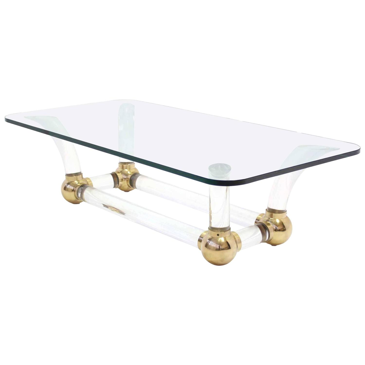 Heavy lucite and brass base thick glass top coffee table for Heavy glass coffee tables