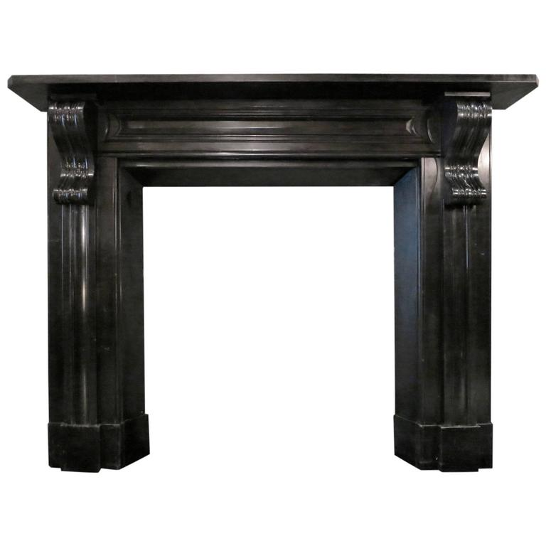 Antique early 19th century irish black marble fireplace for Marble mantels for sale