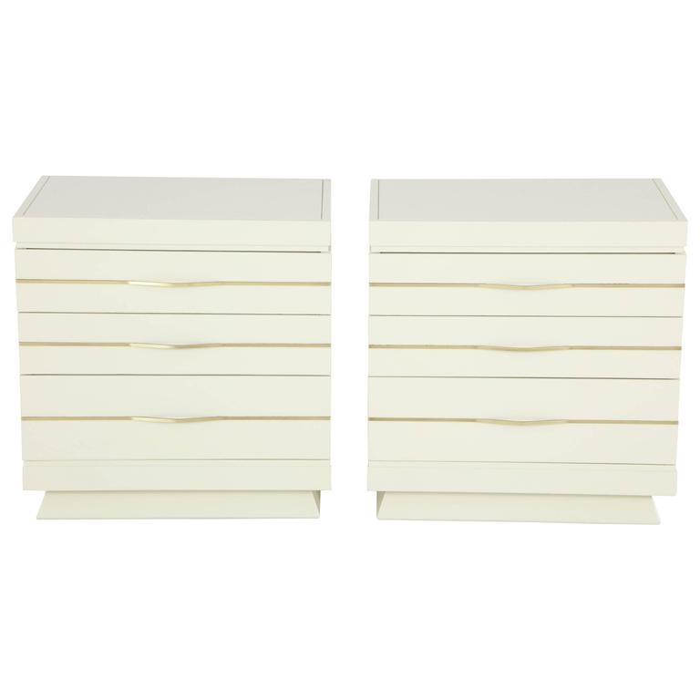 Sleek 1950s Ivory Lacquered Chests with Brass Bar Hardware