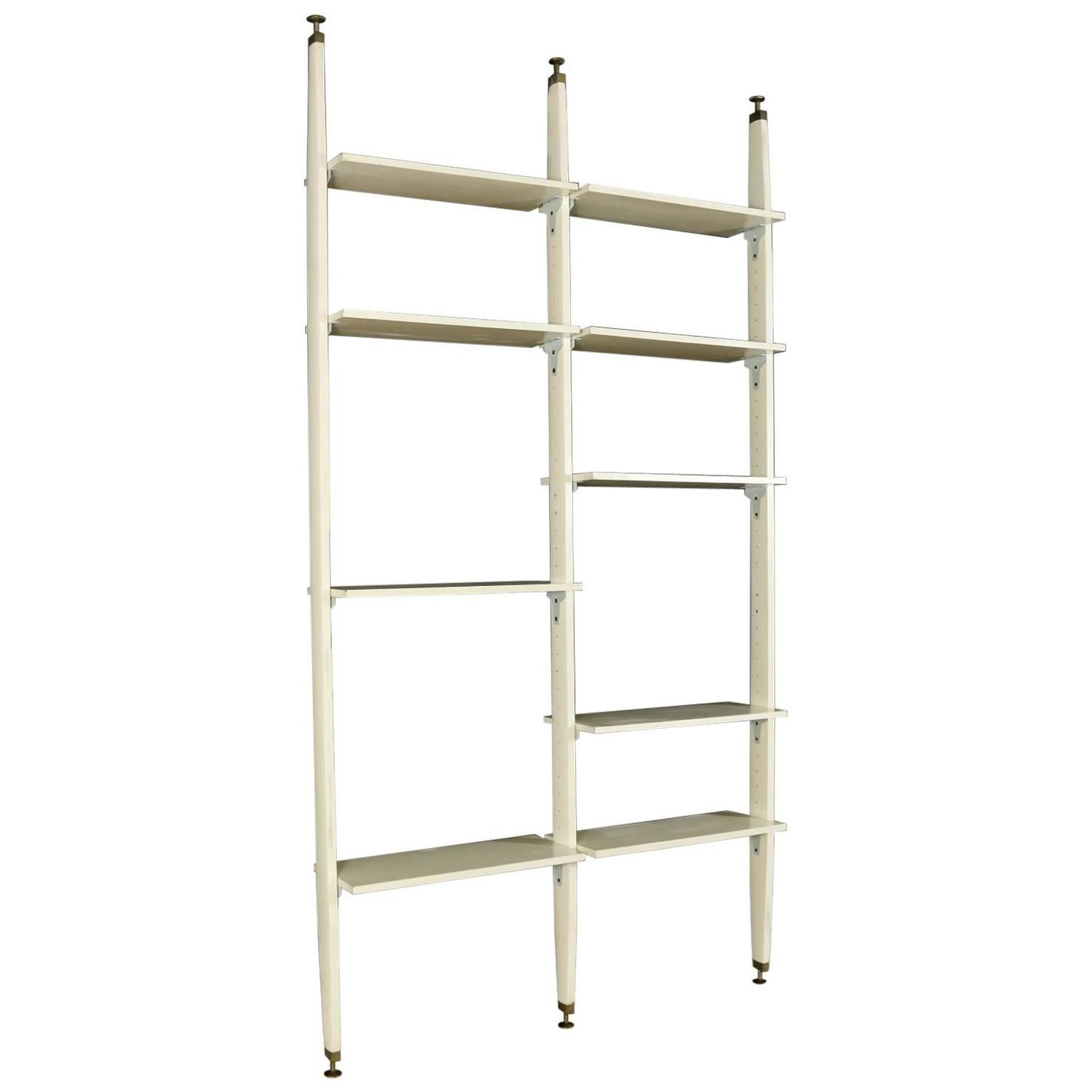 floor to ceiling bookcase lacquered wood brass. Black Bedroom Furniture Sets. Home Design Ideas
