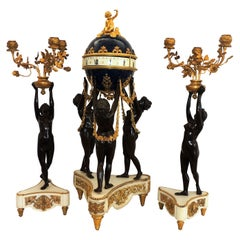 Exceptional French Three-Piece Rotary Mystery Clock Set Maiden Candelabra Suite