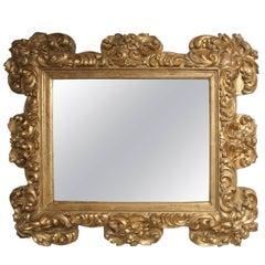 Italian Baroque Carved Giltwood Mirror, circa 1700