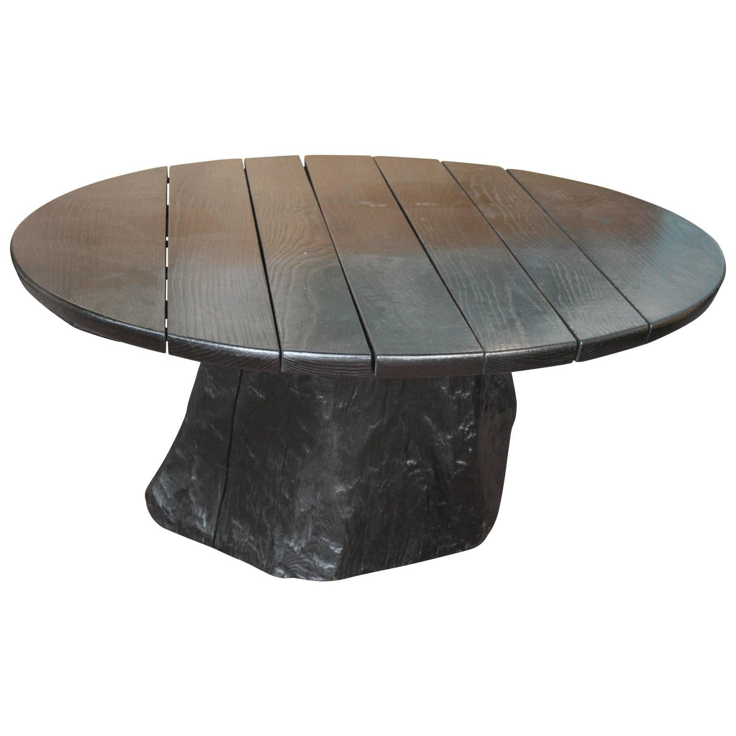 round ebonized oak coffee table with live edge tree trunk base for