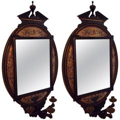 Pair of Englist Aesthetic Movememnt Ebonized and gold decorated mirrors
