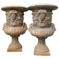 Pair of Large European Cast Garden Urns with Mascarons, Rams Heads, and Grape