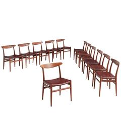 Early Set of 12 Hans J. Wegner Chairs with Original Leather