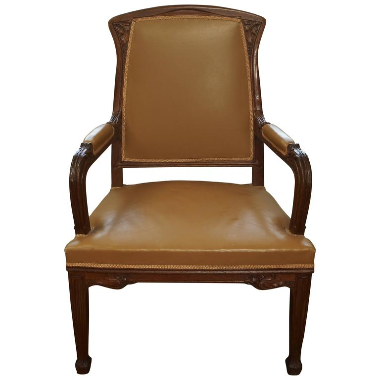 Carved mahogany and leather Art Nouveau desk chair from France, circa 1900. Reminiscent of Majorelle and Galle Nancy.