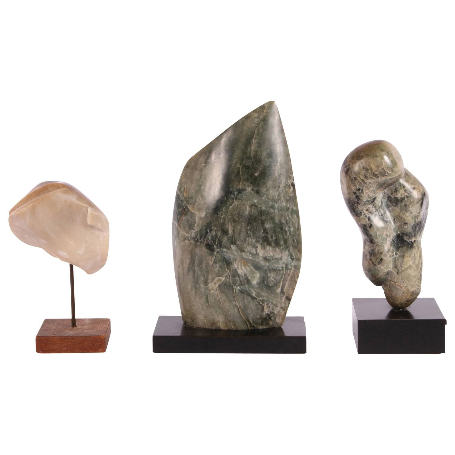 Group of three mid century abstract stone sculptures for