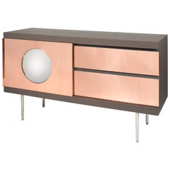 Alice. Sideboard; brushed stained oak. Copper. Convex mirror. Patrick Naggar.