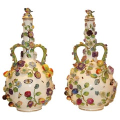 Pair of Continental Porcelain Bottle Form Vases with applied Fruits and Flowers