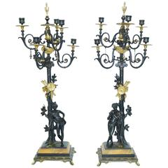 Pair of Neoclassical Bronze Two-Tone Figural Candelabra